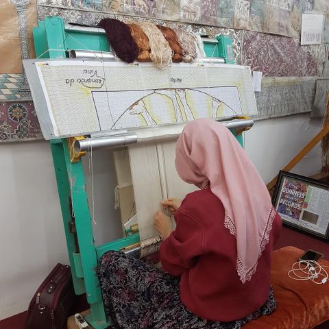 Turkish Woman Demonstrating Carpet Weaving