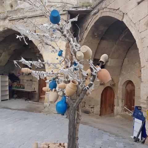 Tree with clay pots in Goreme. Cappadocia, Turkey
