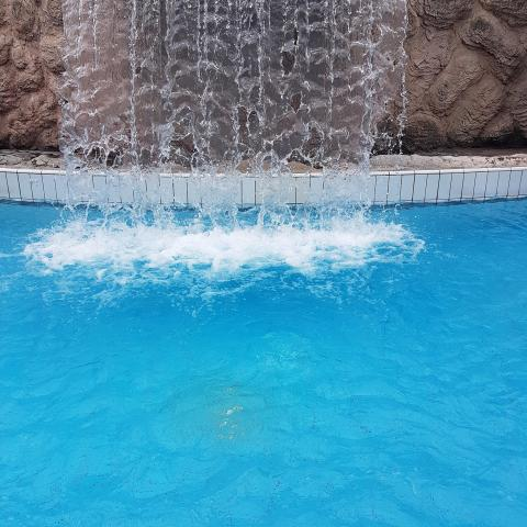 Waterfall in the pool - water droplets