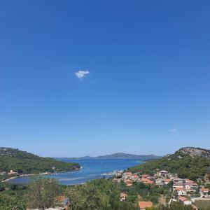Hazy summer Adriatic sea with islands on horizon, Croatia