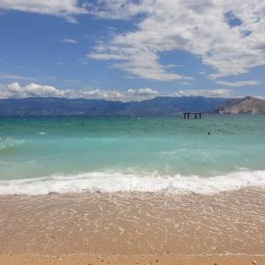 Sea horizon, bright sunny seascape, blue sky and turquoise wave