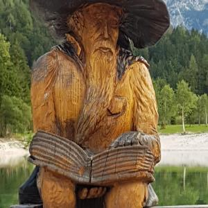 Wooden figure by Lake Jasna Kranjska Gora - Slovenia